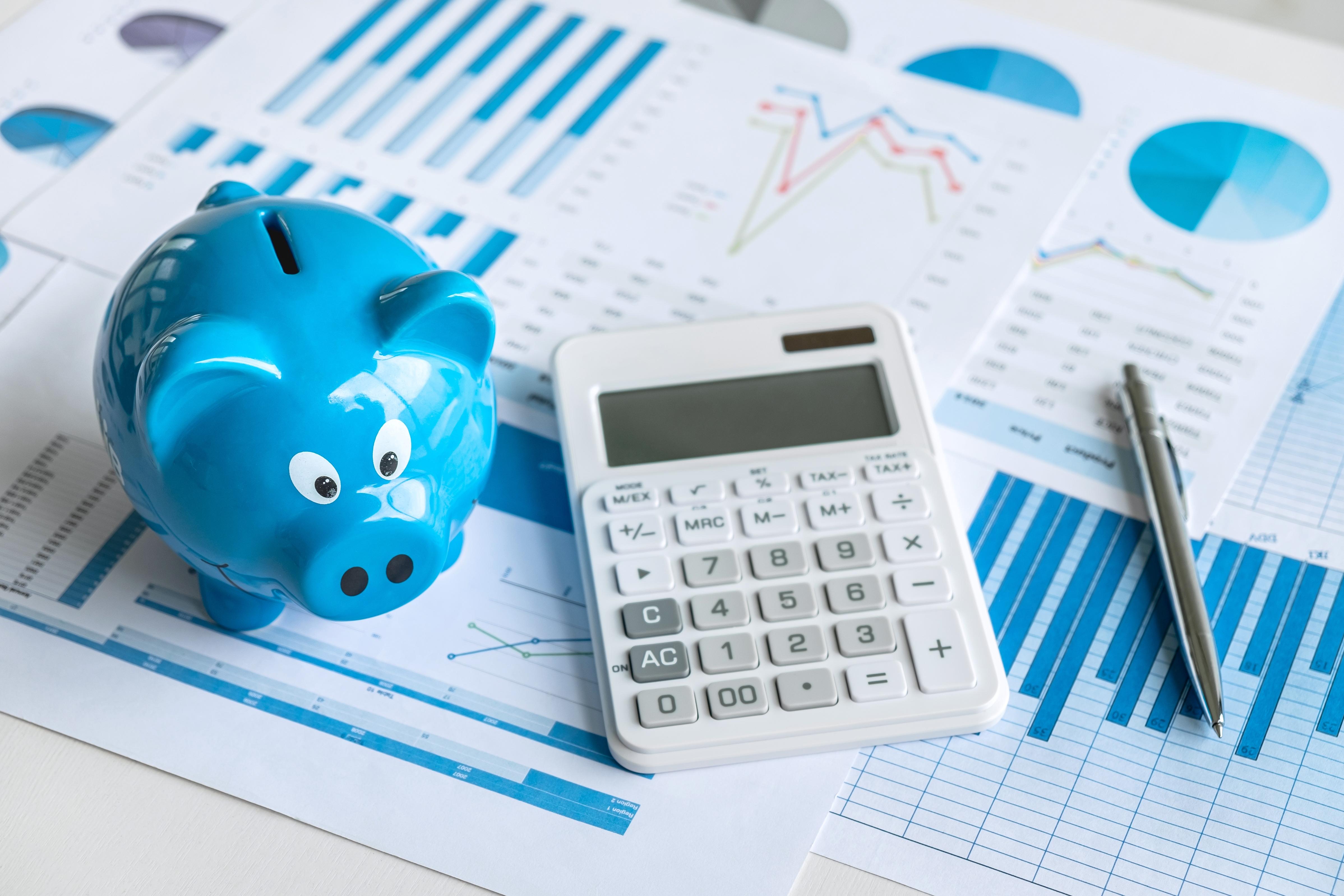 papers, calculator & piggy bank