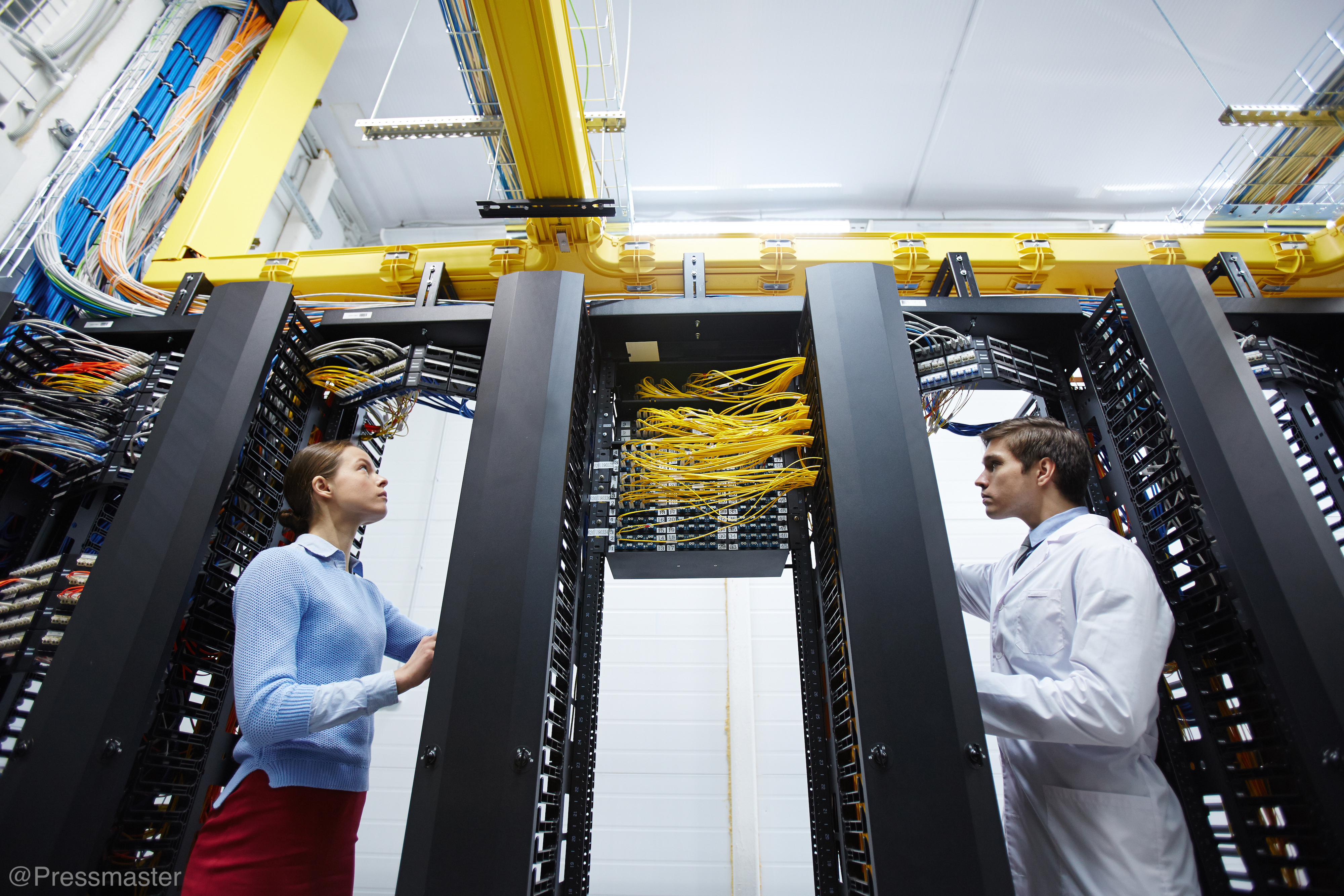 """""""Female-and-Male-Working-In-Server-Room-Large-Scale-Tech-Job"""""""