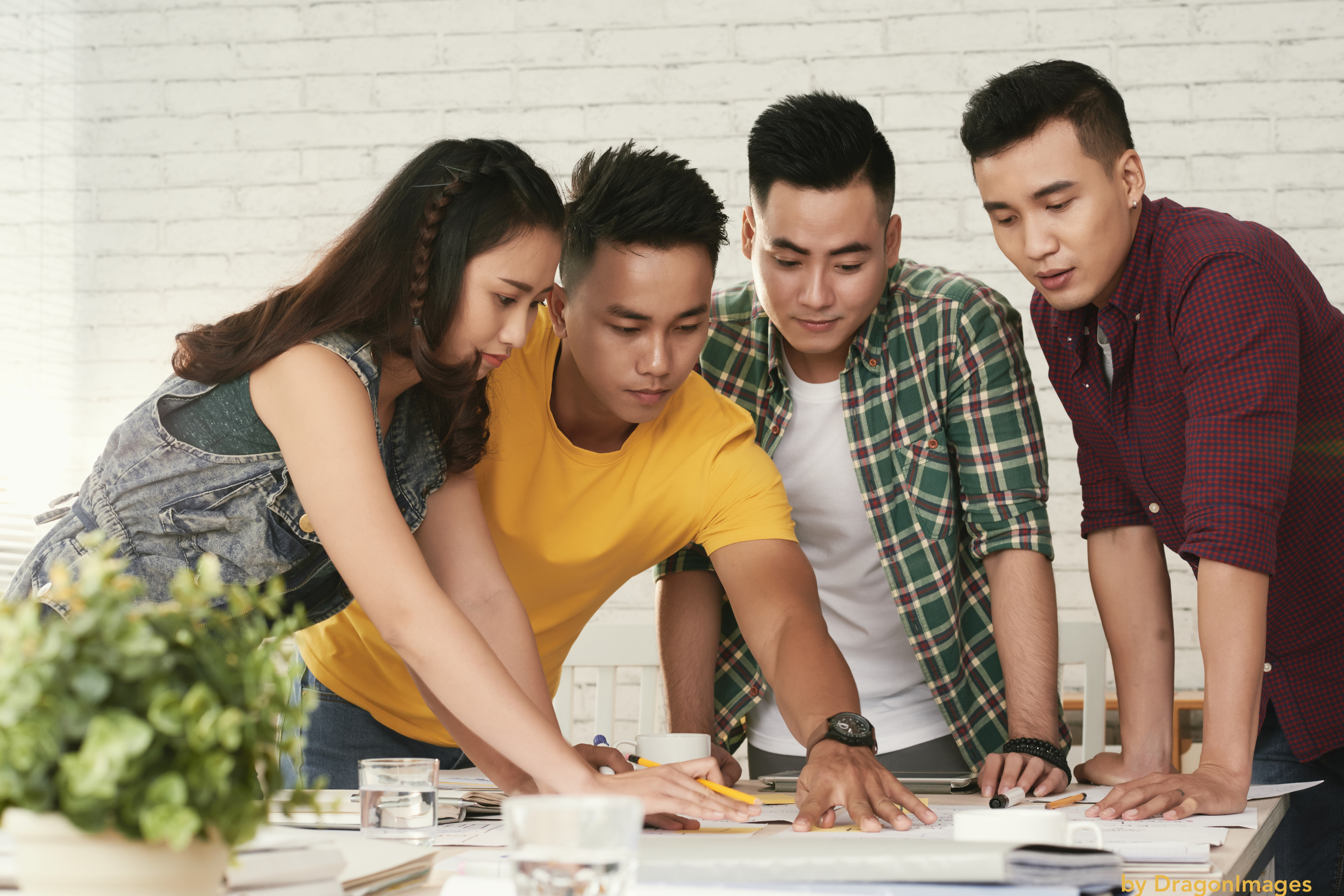 group-of-four-co-workers-making-plans
