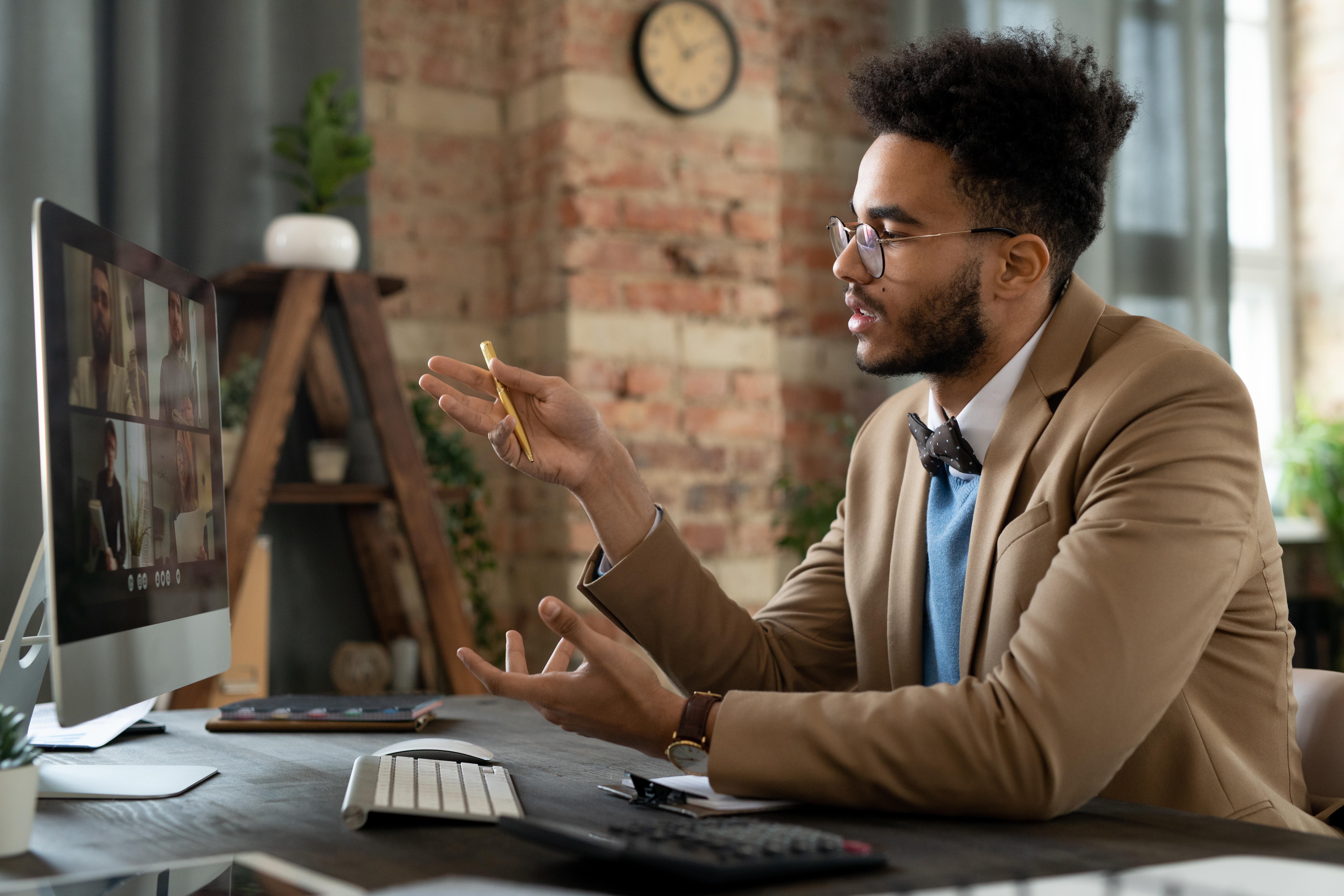 Man on video call for career center webinar