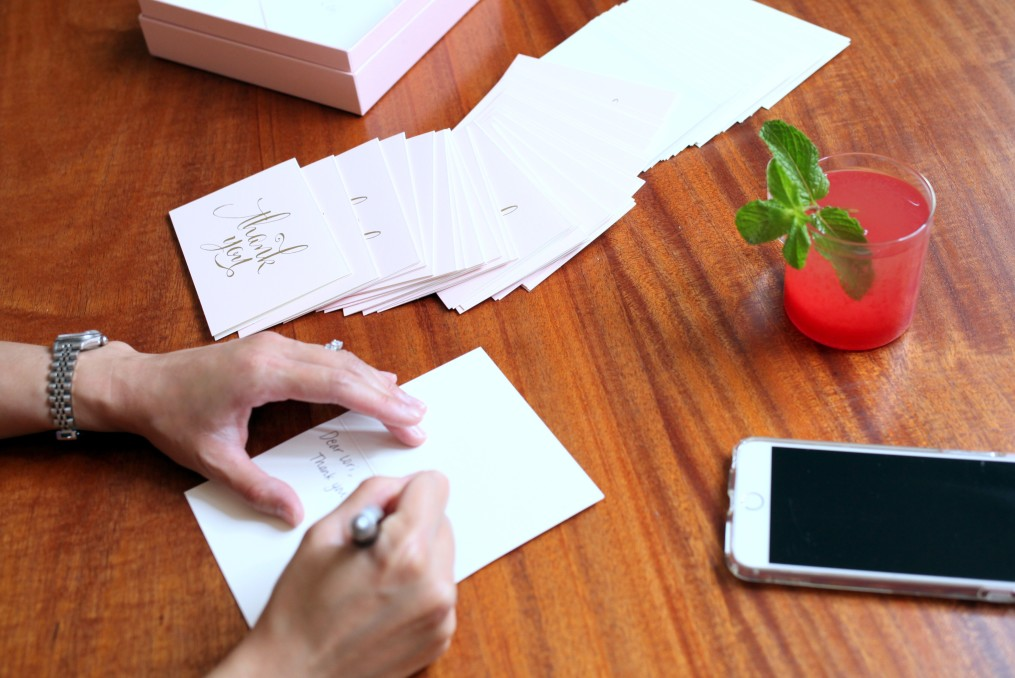 Person hand-writing thank you notes