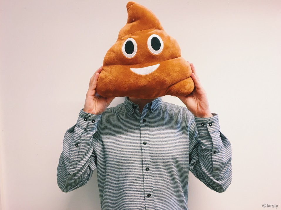 Man holding emoji symbol for soft-serve ice cream pillow in front of his head for a laugh